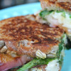 Grilled White Peach, Pesto, White Cheddar, and Arugula Grilled Cheese
