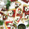 Grilled Watermelon Pizza with Herb Pistachio Pesto, Mozzarella, and Honey