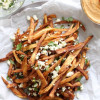 Feta, Herb & Lemon Garlic Fries with Spicy Harissa Hummus
