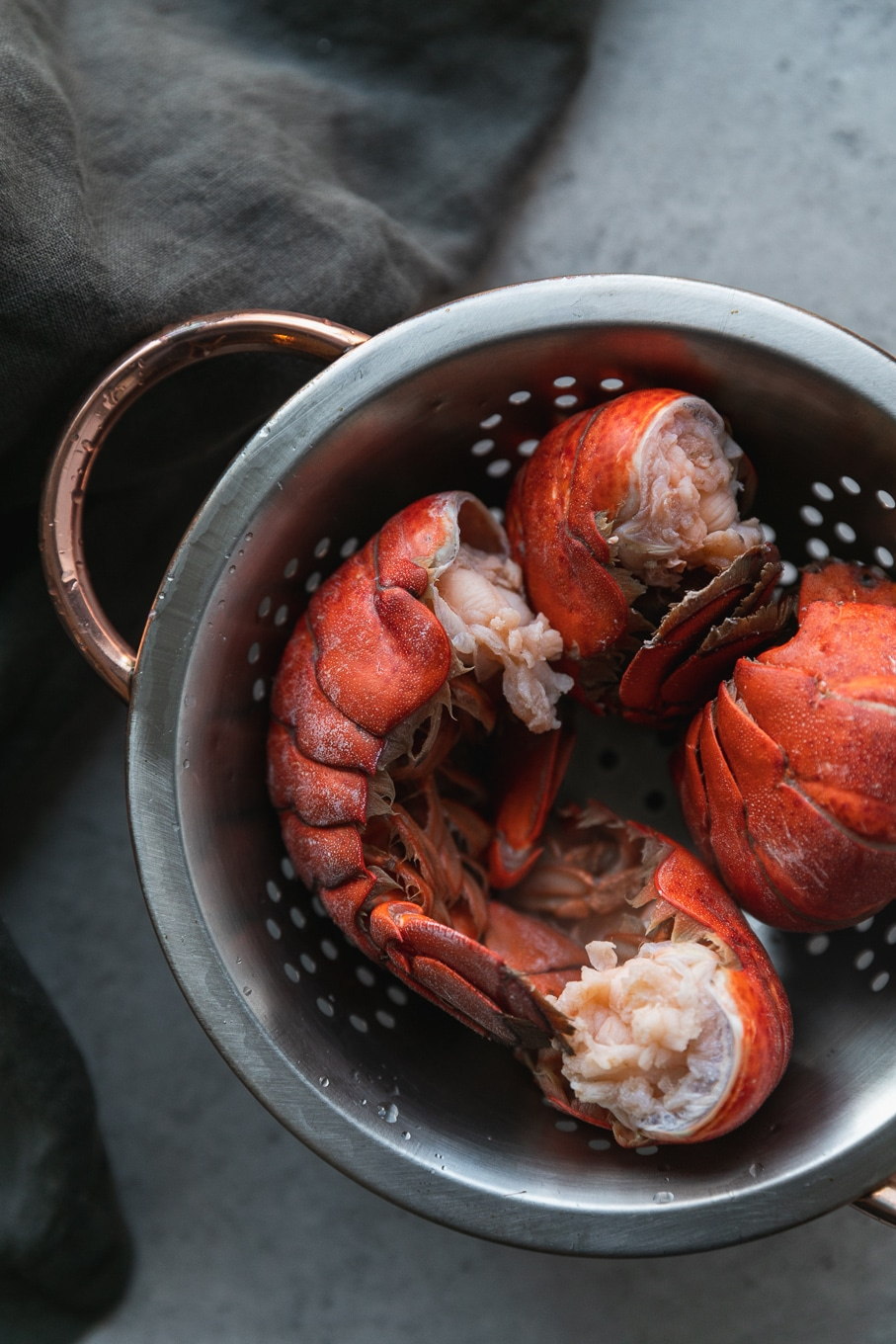 Overhead shot of a colander filled with lobster tails