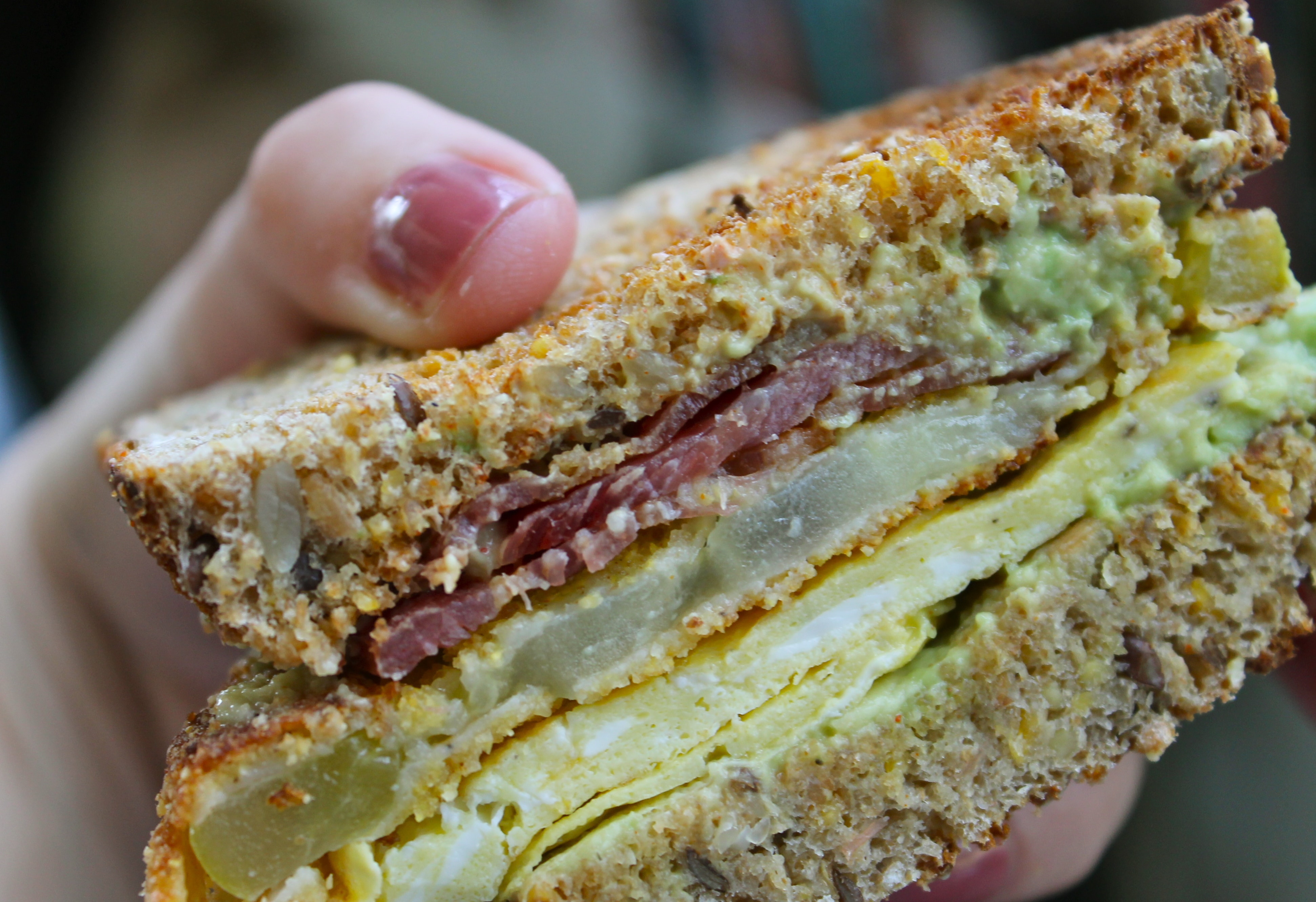 Fried Green Tomato Egg Sandwiches with Applewood Smoked Bacon, Avocado, Cheddar, and Spicy Aioli