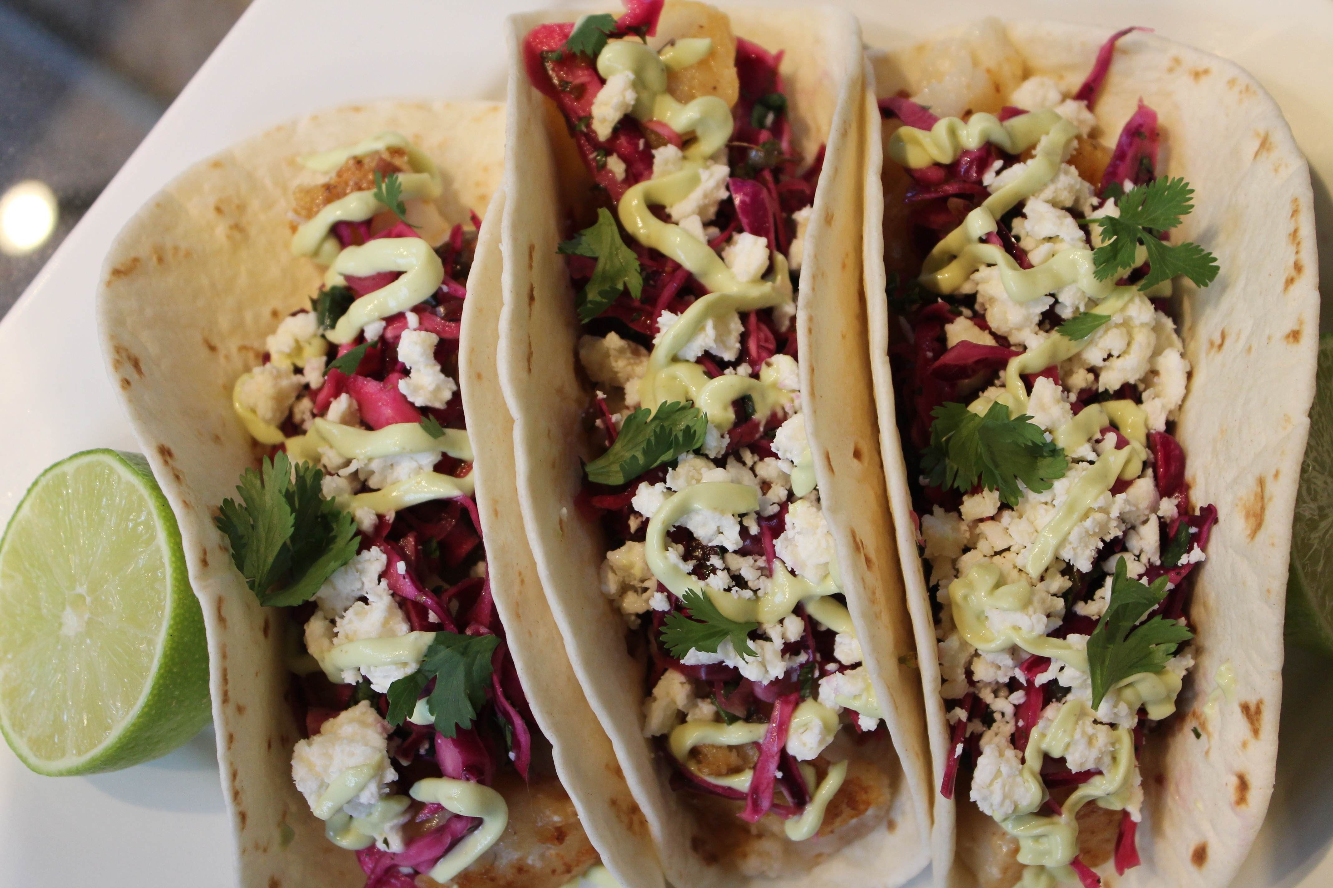 Beer battered fish tacos with cilantro lime red cabbage for Fish taco red cabbage slaw