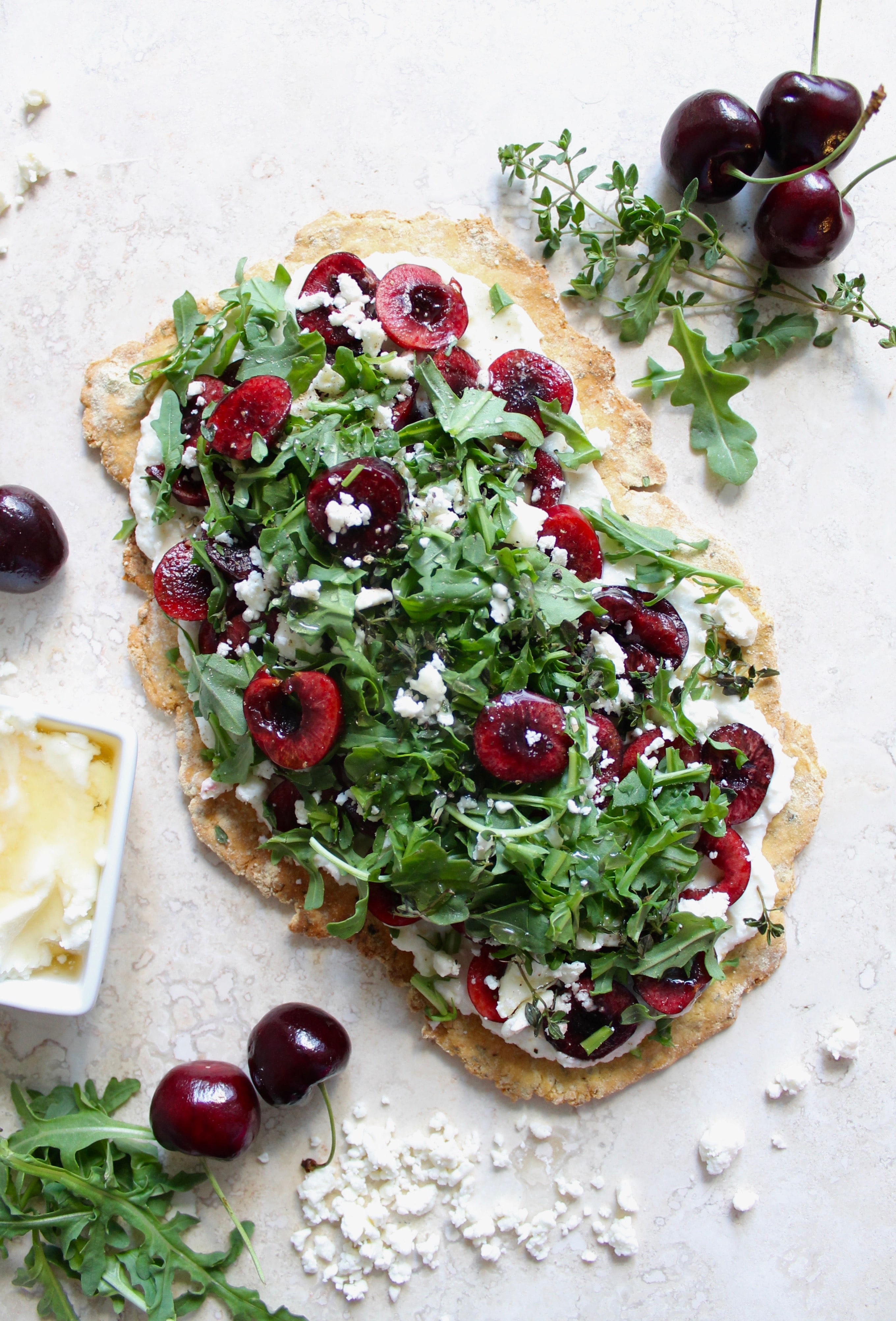 Chickpea Flour Flatbread with Cherries, Honey Ricotta, Feta, and Arugula (gf)