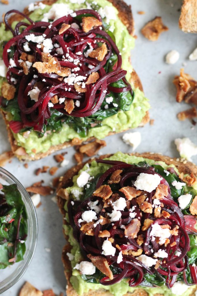 Avocado Toast with Beet Noodles, Garlic Swiss Chard, Bacon, and Feta