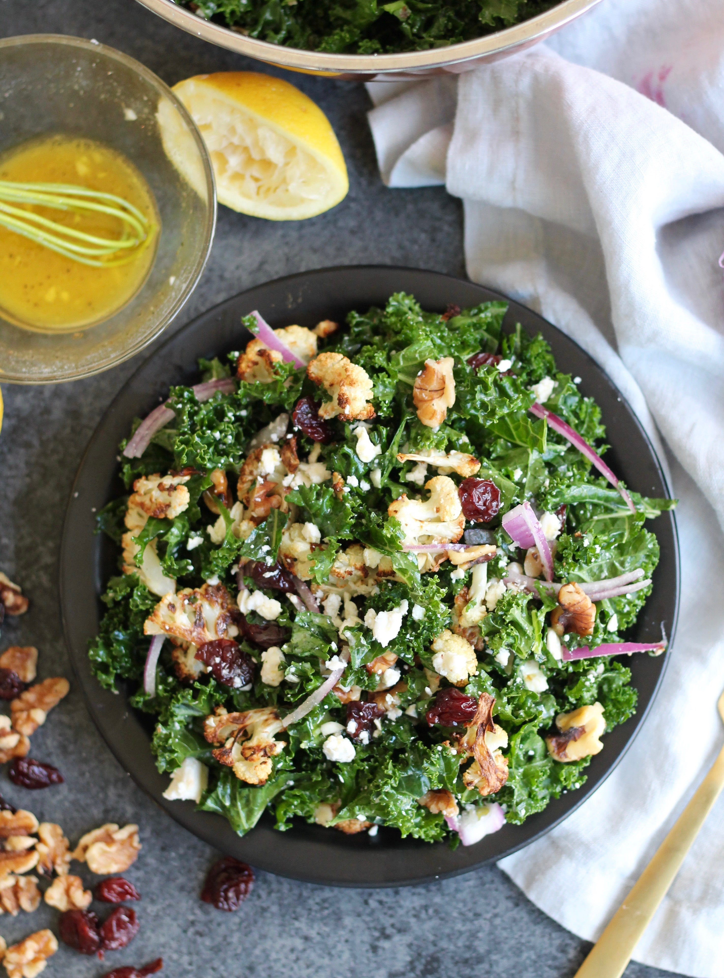 roasted cauliflower kale salad with dried cherries walnuts and feta