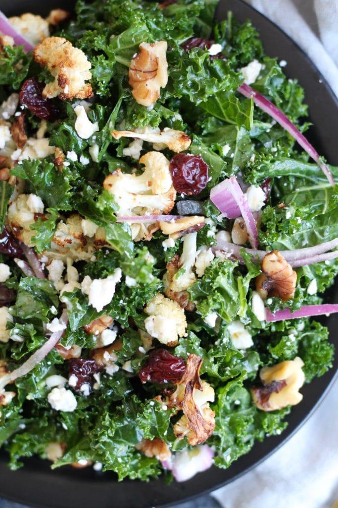 Roasted Cauliflower Kale Salad with Dried Cherries, Walnuts, and Feta