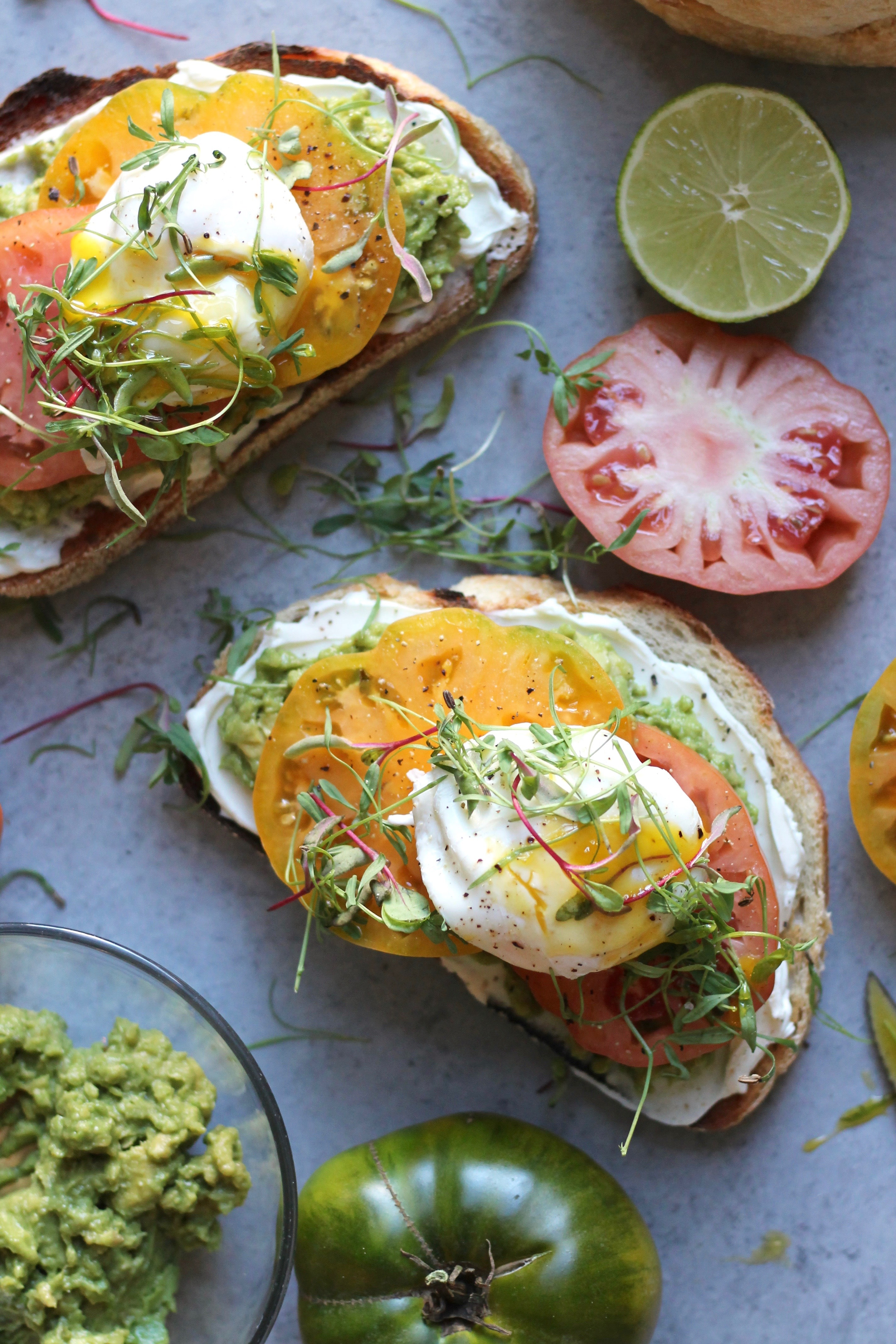 Cream Cheese Avocado Toast with Heirloom Tomatoes and Poached Eggs