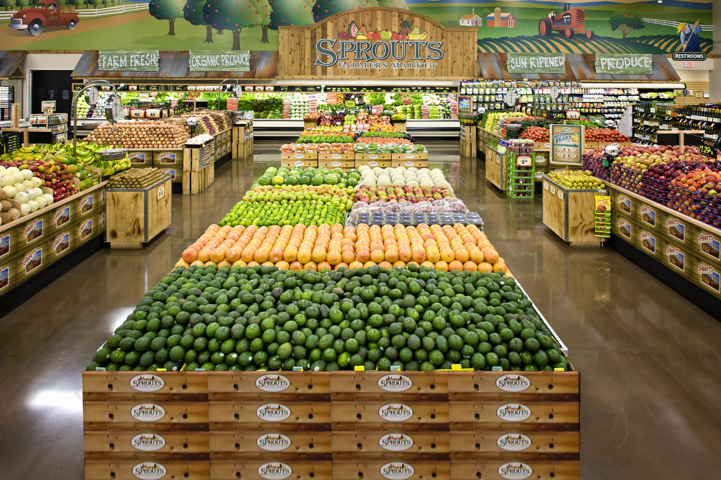 Wide pan shot of the produce section of a Sprouts Farmers Market store