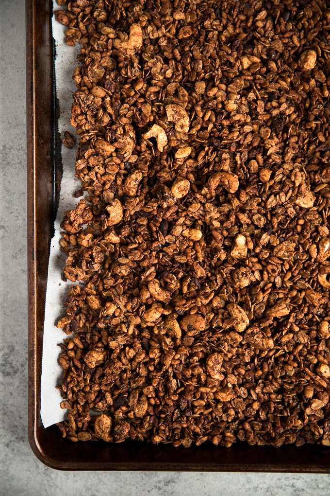 Overhead shot of a rimmed baking sheet filled with granola