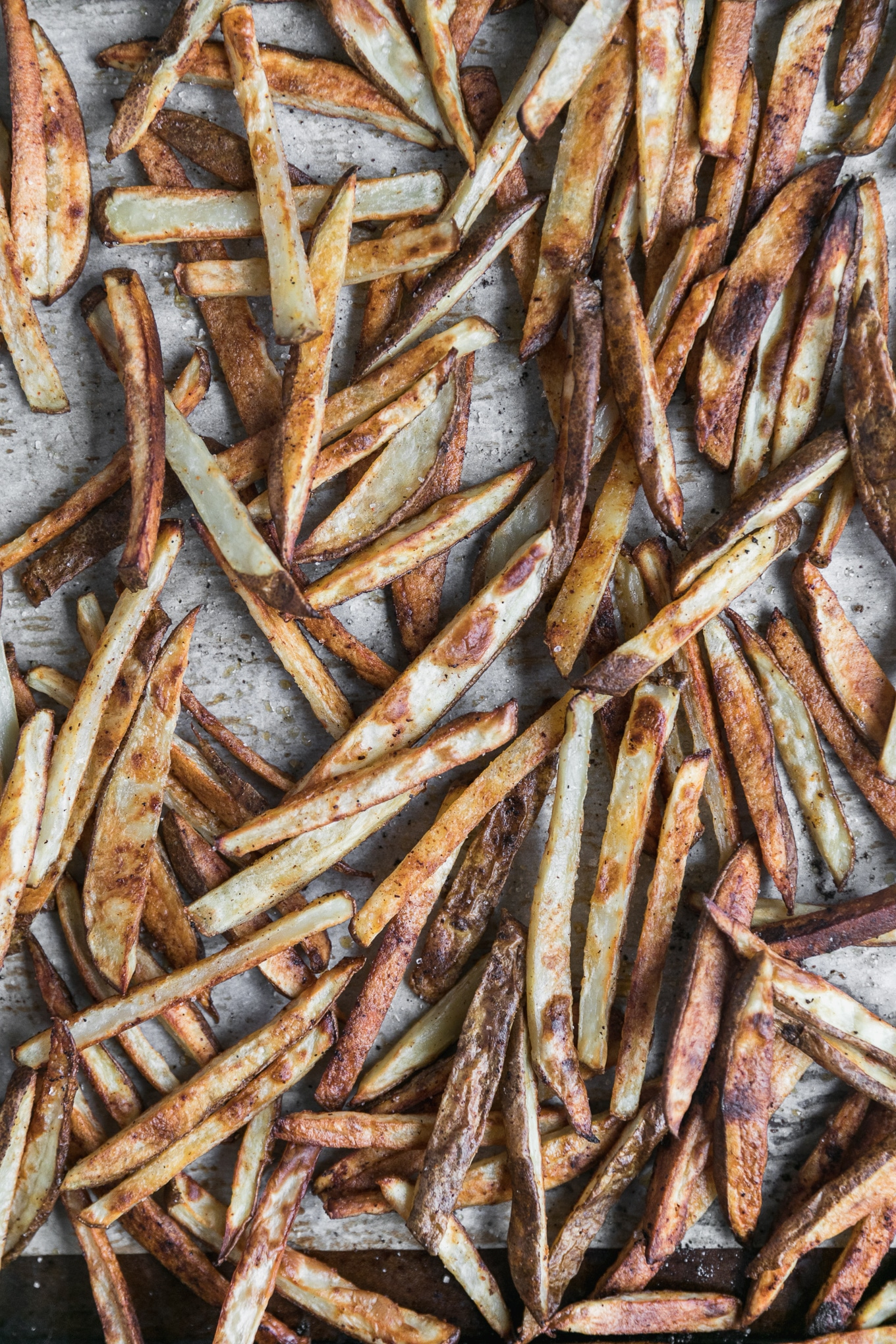 Overhead close up shot of baked golden brown fries