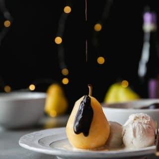 Champagne Poached Pears with Dark Chocolate Fudge Sauce