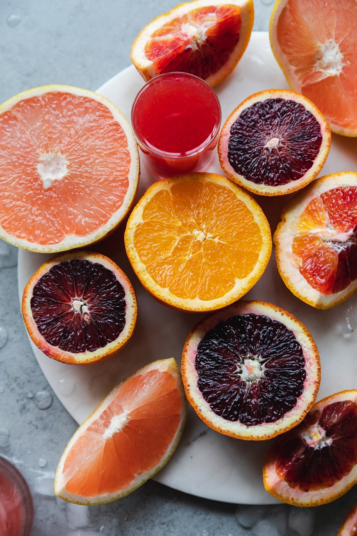 Close up shot of super colorful halved blood oranges, grapefruit, and tangelos