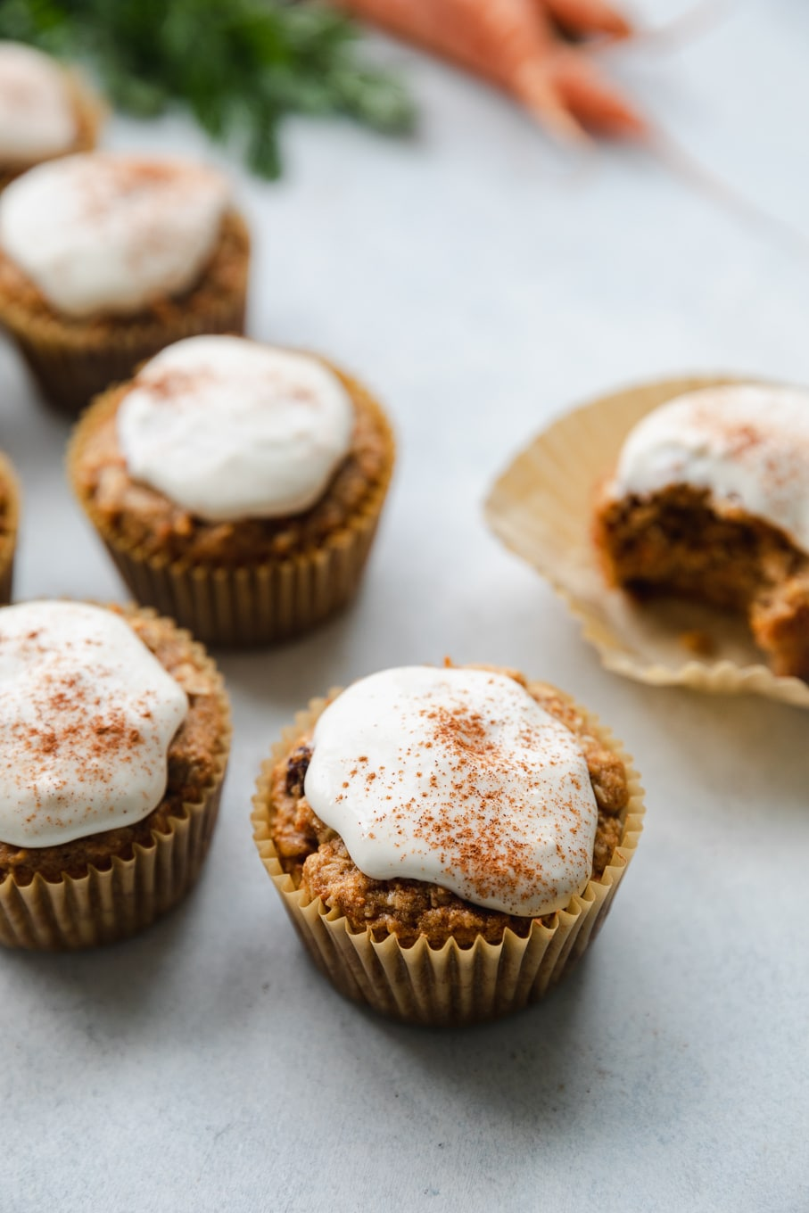 Close up shot of cream cheese glazed carrot cake muffins