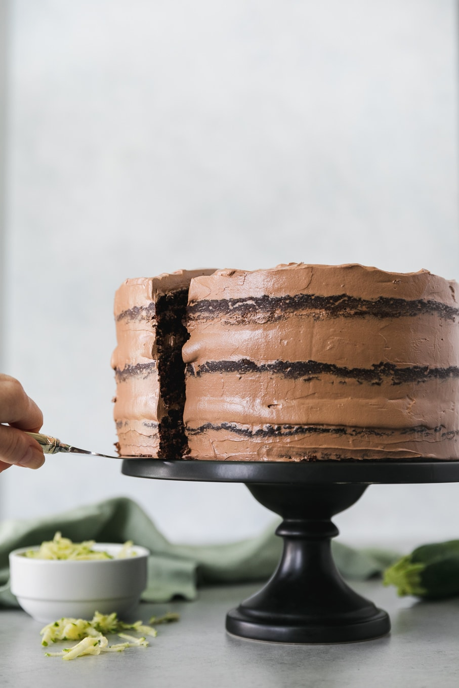 Forward facing shot of a double chocolate zucchini layer cake