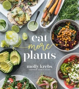 Shot of eat more plants cookbook cover with colorful vegetable dishes