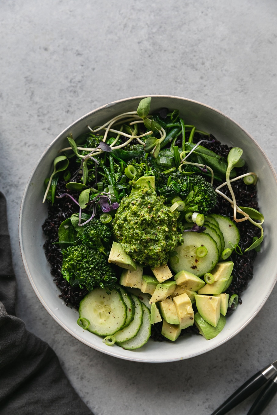 Overhead shot of a black rice green veggie bowl