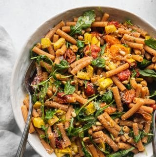 Garlic Roasted Tomato Red Lentil Pasta with Arugula and Toasted Pine Nuts