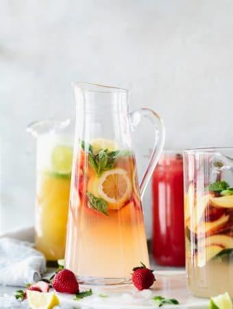 Forward facing shot of 4 pitcher cocktails