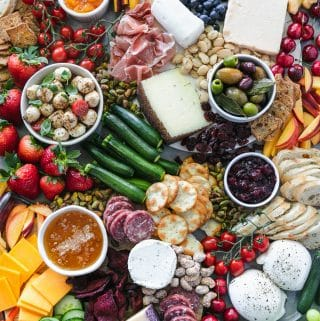 Overhead shot of a colorful summer cheeseboard