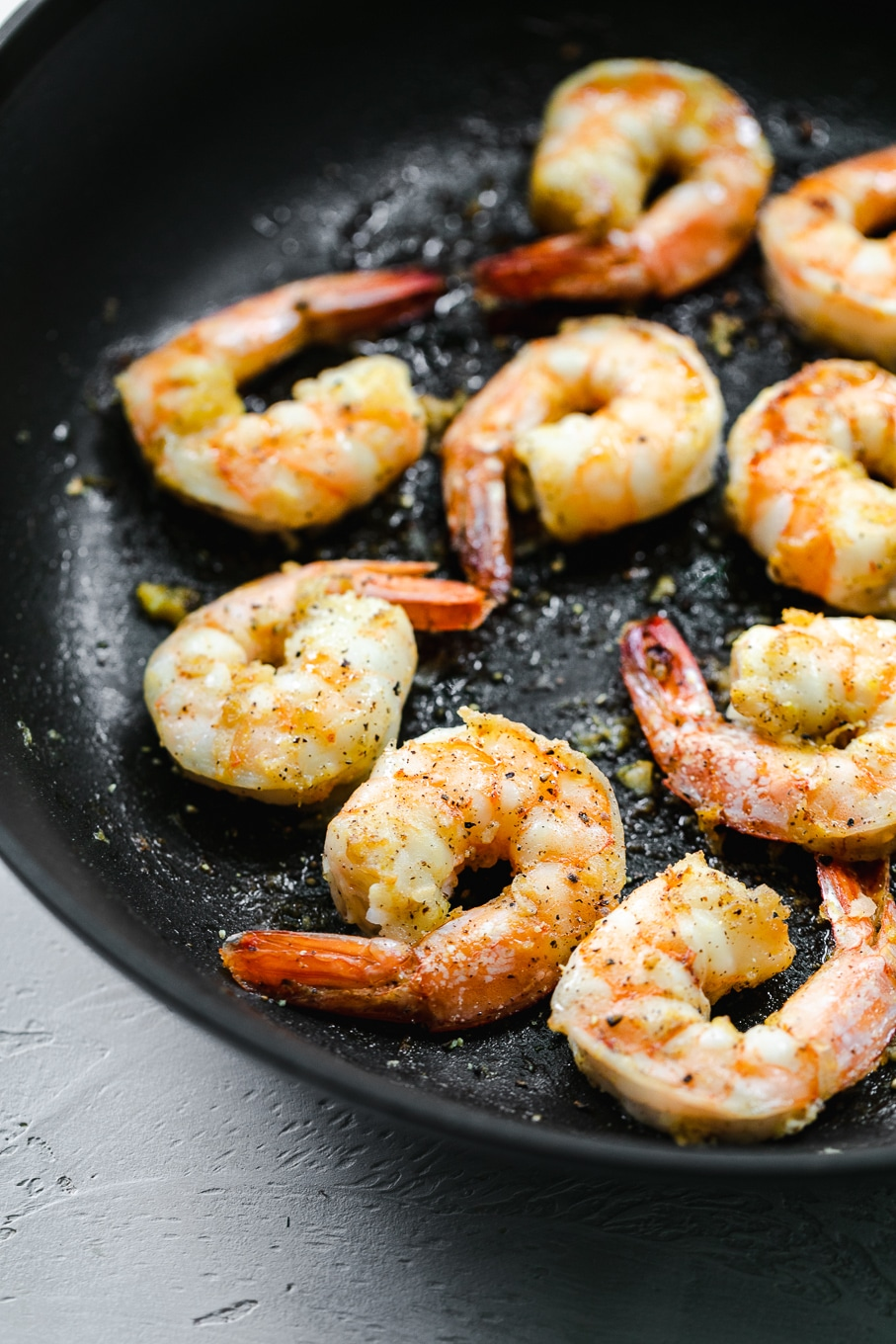 Close up shot of shrimp in a skillet