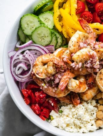 Overhead close up shot of a mediterranean chopped salad with shrimp