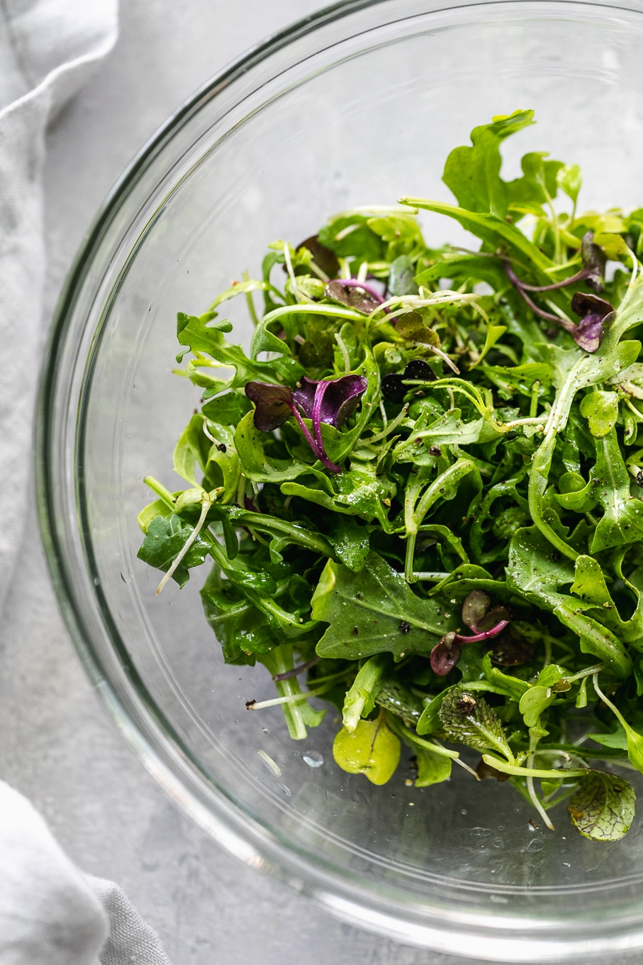 Overhead shot of a bowl of arugula and microgreens