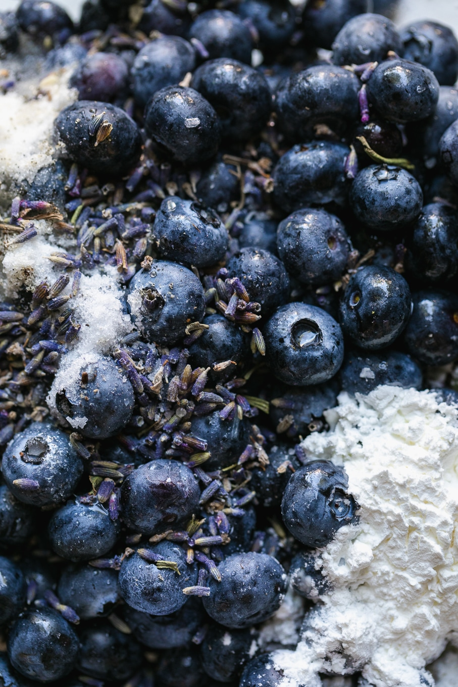Close up shot of blueberries, lavender, cornstarch, and sugar
