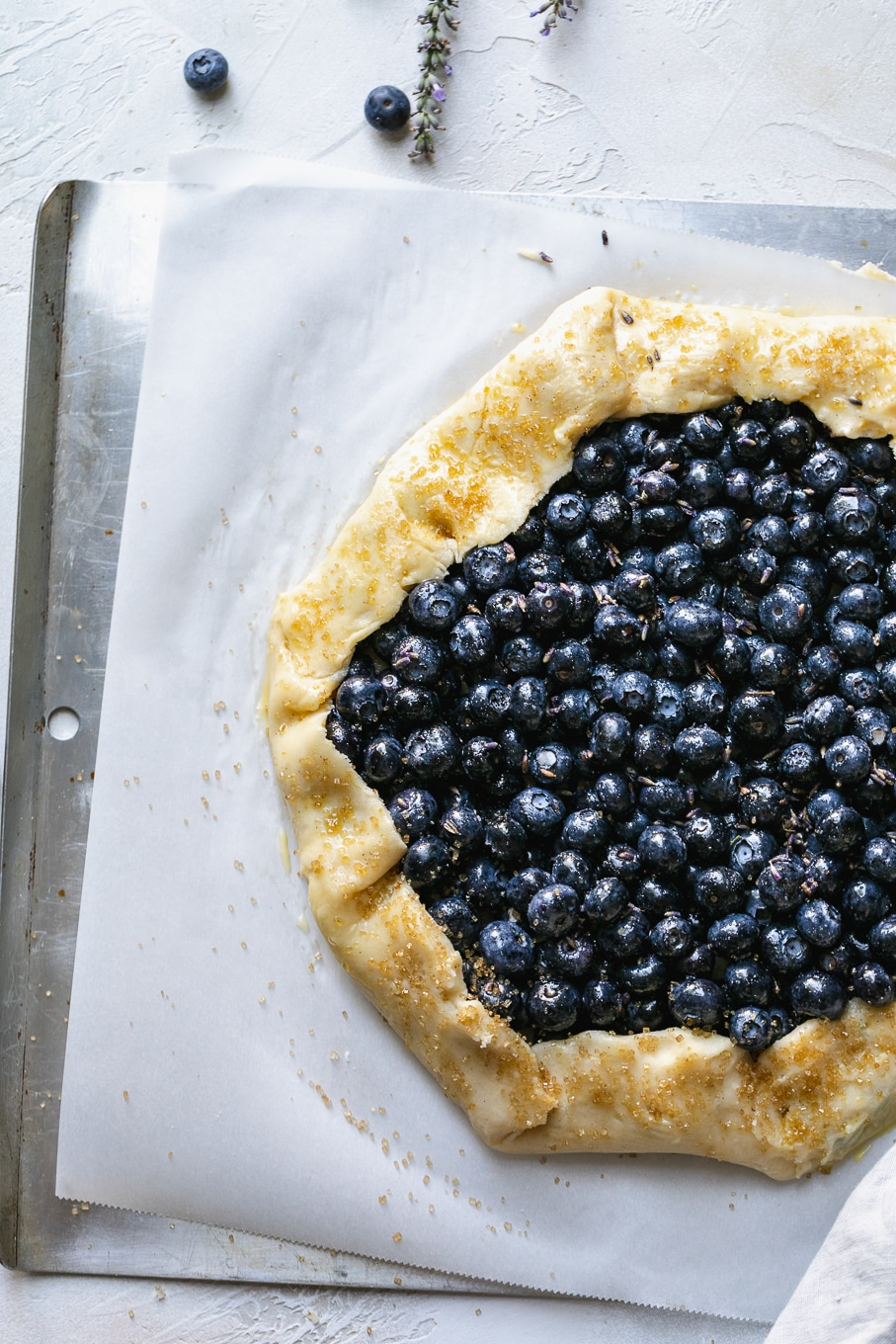 Overhead shot of a blueberry galette before baking