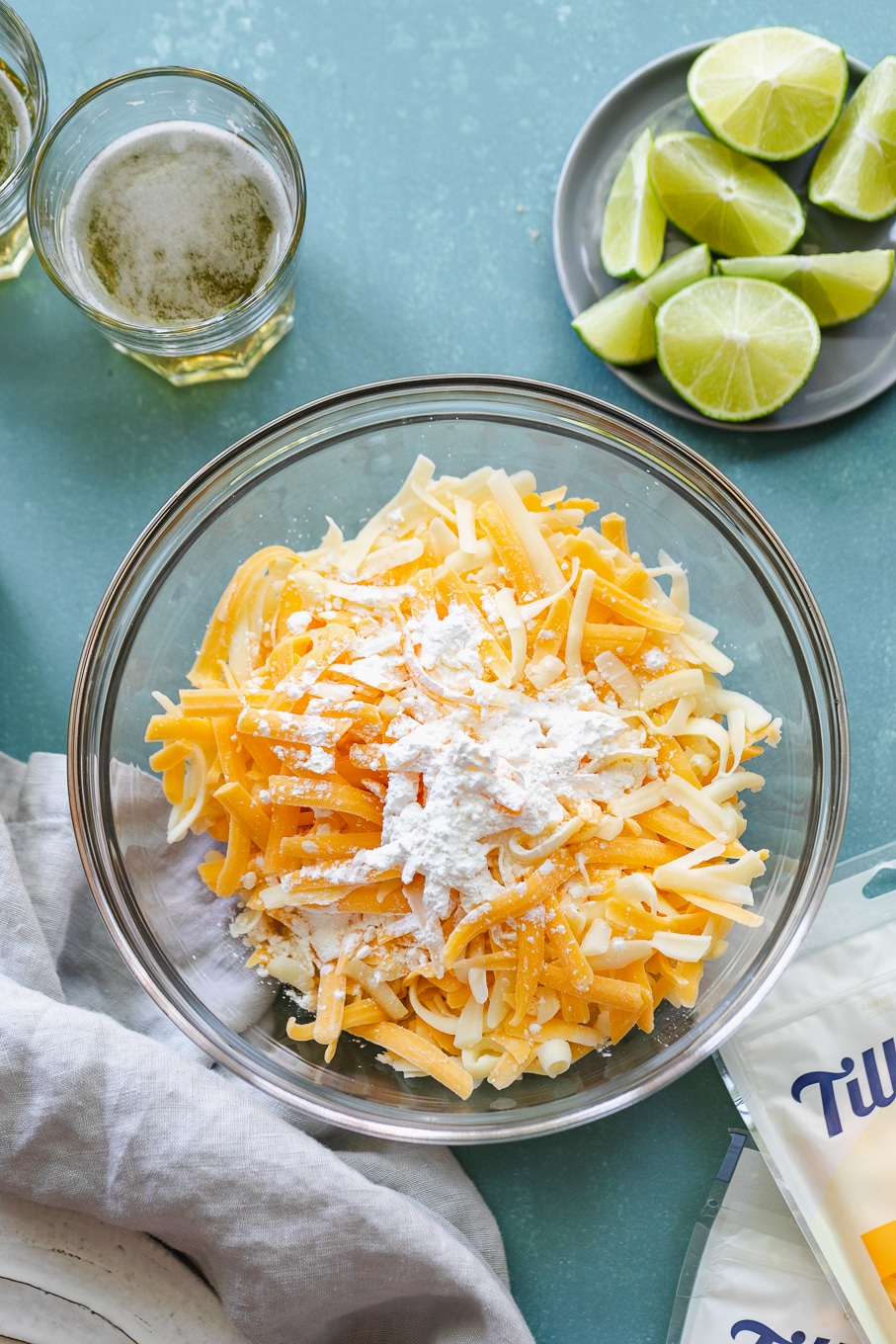 Overhead shot of a bowl of shredded cheeses and cornstarch