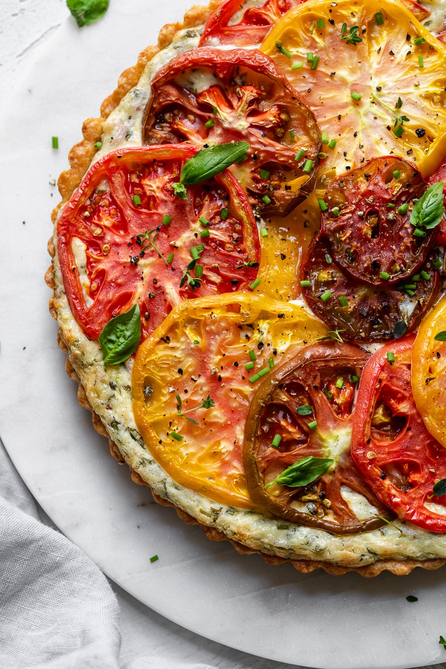 Overhead close up shot of a colorful tomato tart