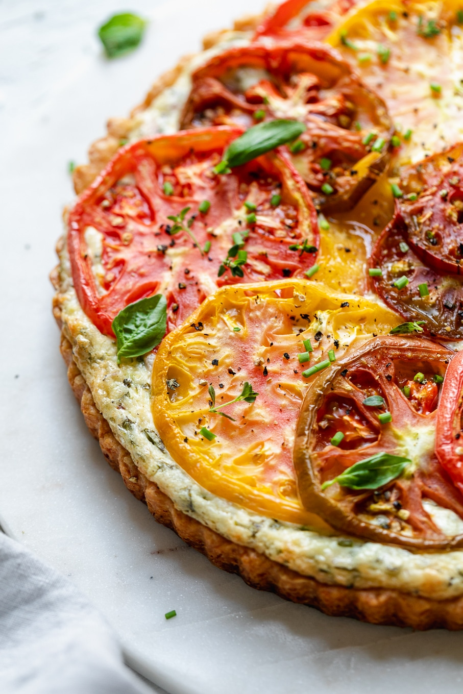 Close up shot of a colorful tomato tart
