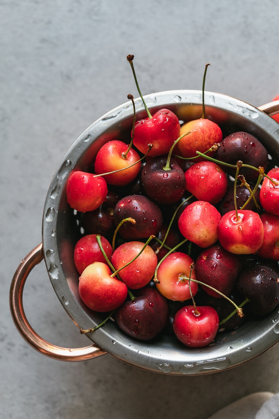 Overhead shot of vibrant cherries in a strainer