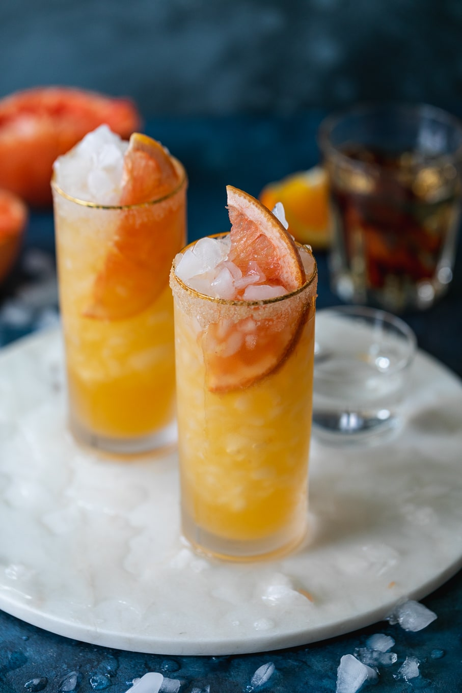 Close up shot of two grapefruit cocktails