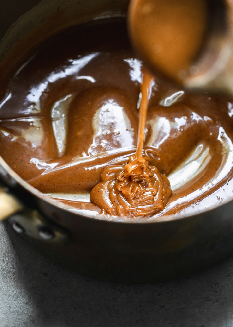 Close up shot of caramel in a pot being drizzled