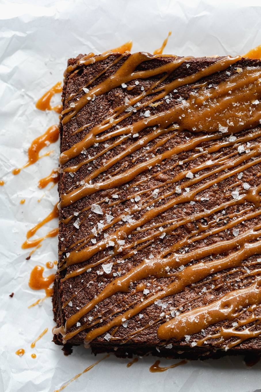 Overhead shot of brownies drizzled with chai salted caramel and sea salt