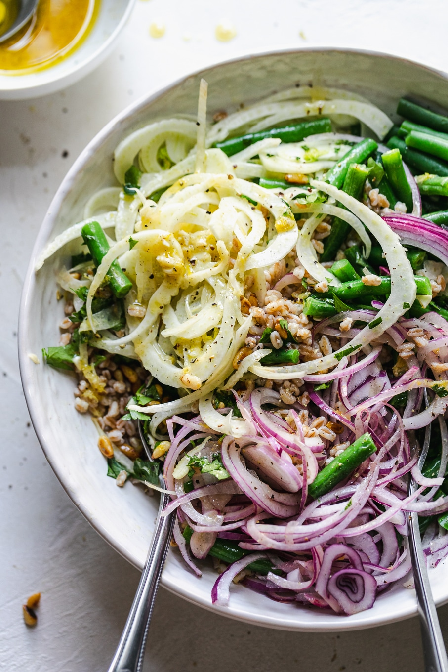Overhead shot of a salad with shaved fennel, red onion, and green beans