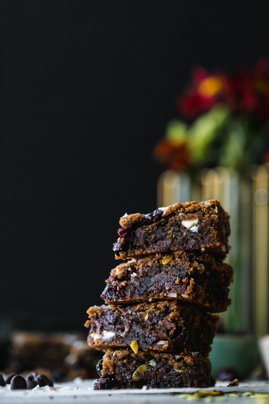 Straight on shot of a stack of blondies against a black background