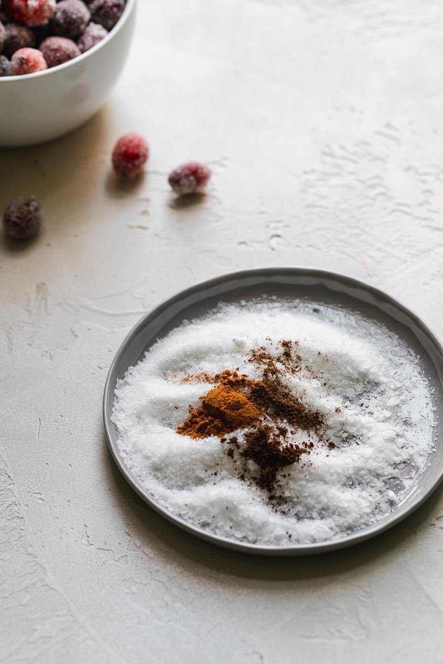 Close up shot of a plate of sugar, salt, and spices