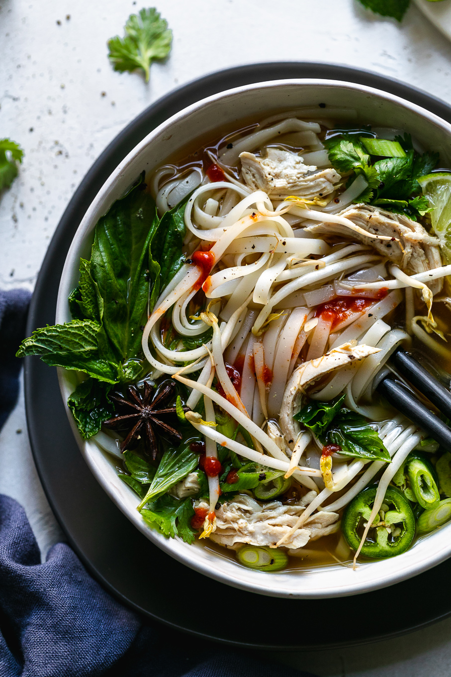 Overhead shot of a colorful bowl of pho with chopsticks in the bowl