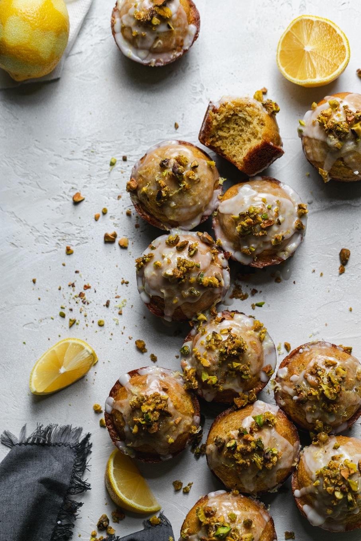 Overhead shot of lemon pistachio muffins arranged in a line