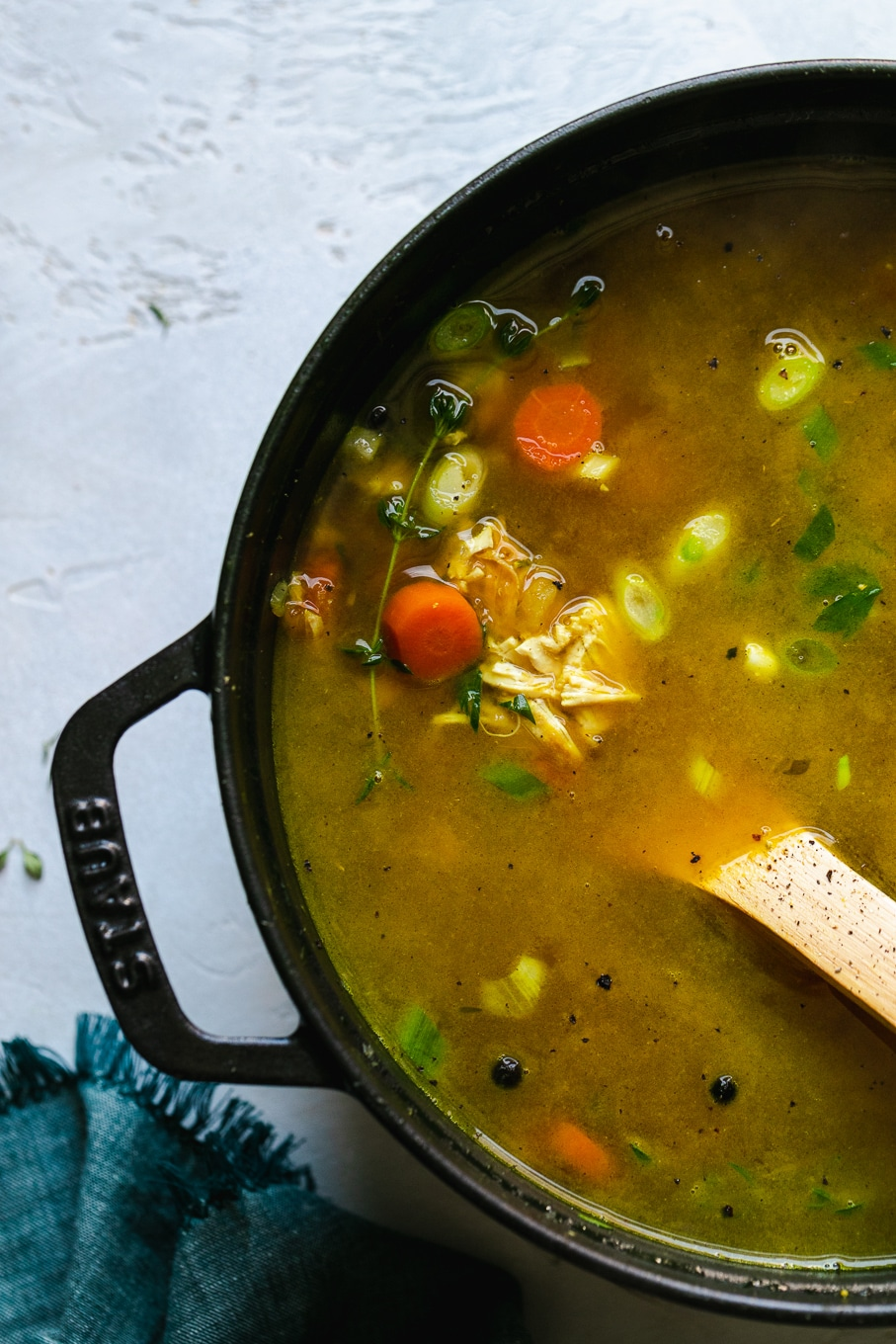 Overhead shot of a black dutch oven filled with chicken noodle soup