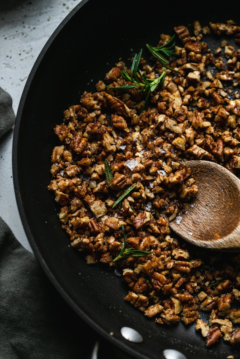 Close up shot of rosemary pecan crunch in a skillet