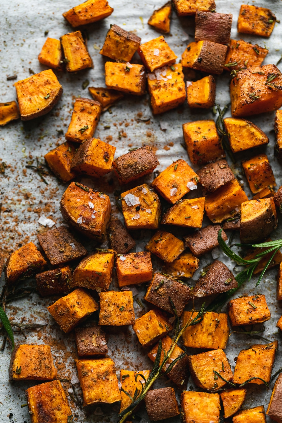 Overhead close up shot of diced roasted sweet potatoes