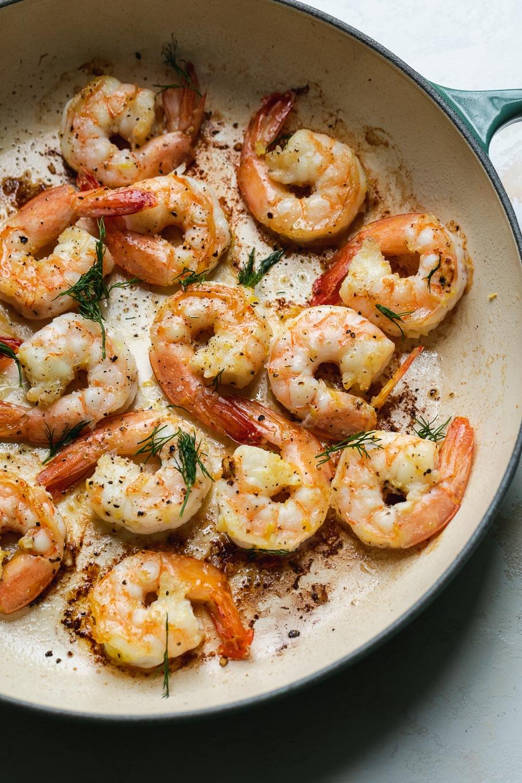 Close up shot of a pan with sautéed shrimp
