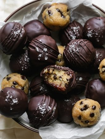 Close up shot of chocolate covered cookie dough truffles